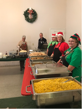 LogistiCare Norton Managers Serving Food