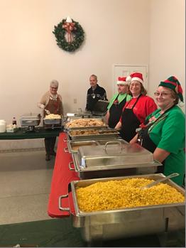 LogistiCare Norton Managers Serving Food
