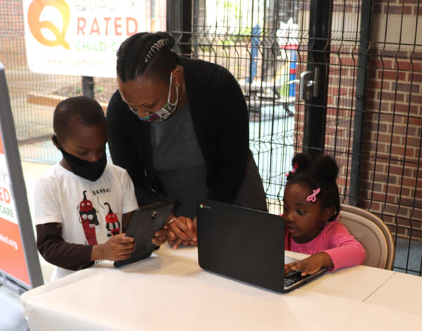 Atlanta Children's Shelter student look at new tablets and Chromebooks